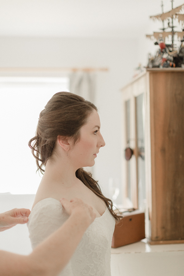 bride looking at herslef in the mirror