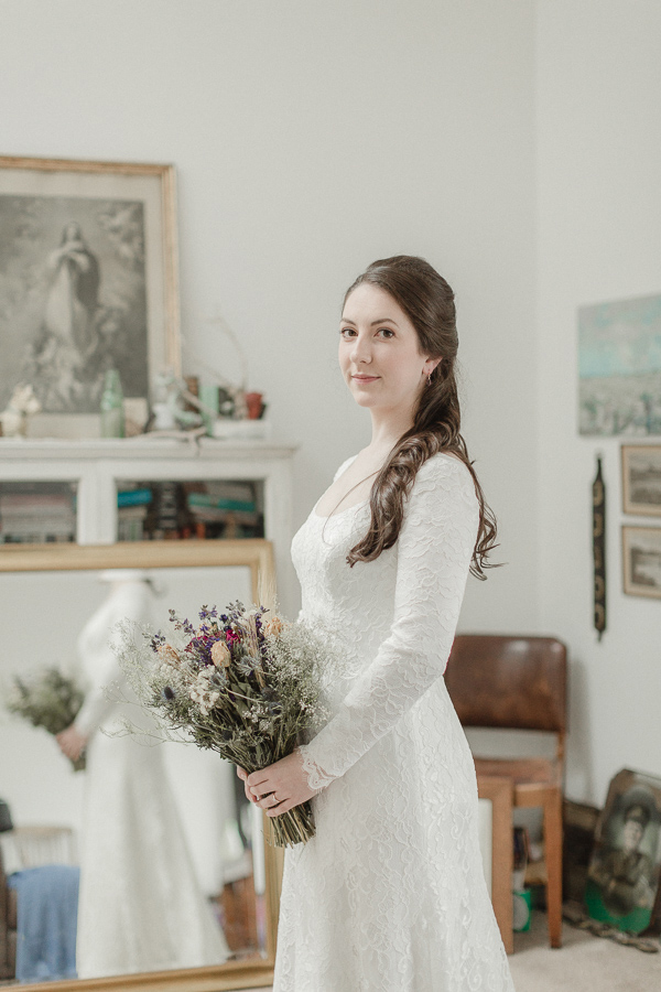 bride holding flowers and looking at the camera