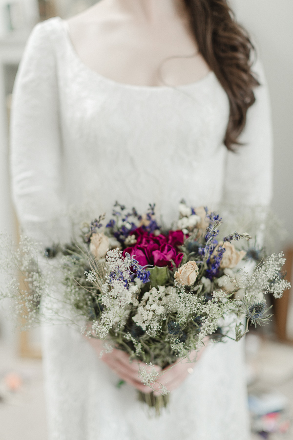 scottish bride holding dried flowers on isle of harris