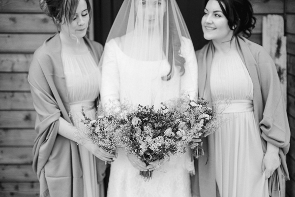 bride and bridesmates holding flowers