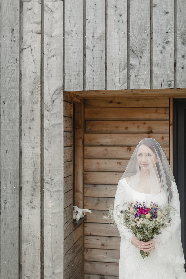 bride outside her home in harris