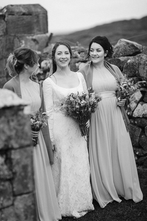 bride laughing with bridesmates just outside the church in scotland