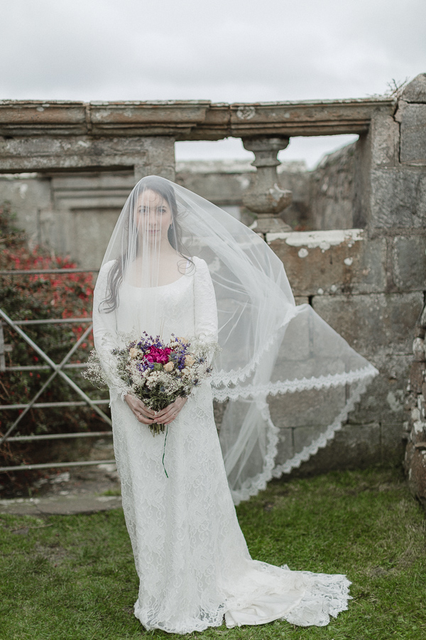 bride having her veil move by the wind scotland