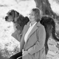 portrait woman with dog sitting in coat joga teacher