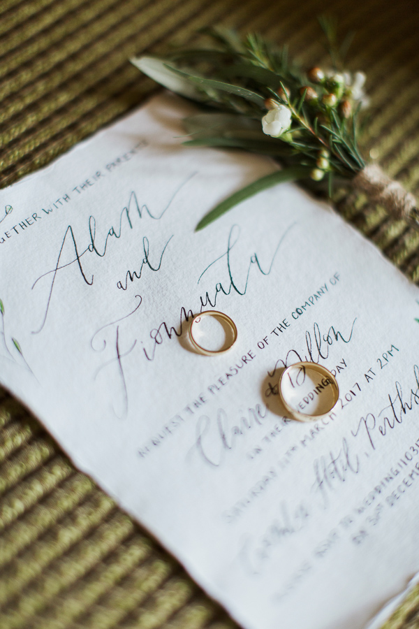 wedding invitations and rings at the luxury hotel cromlix