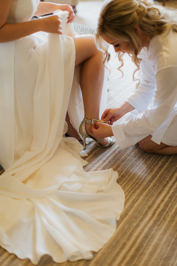 helping the bride with shoes cromlix
