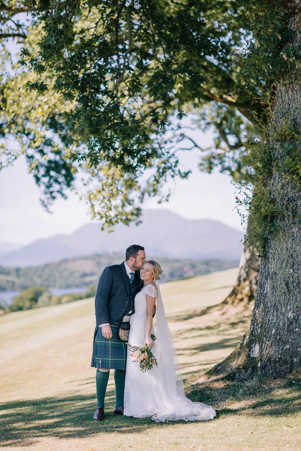 a couple photographed by loch lomond