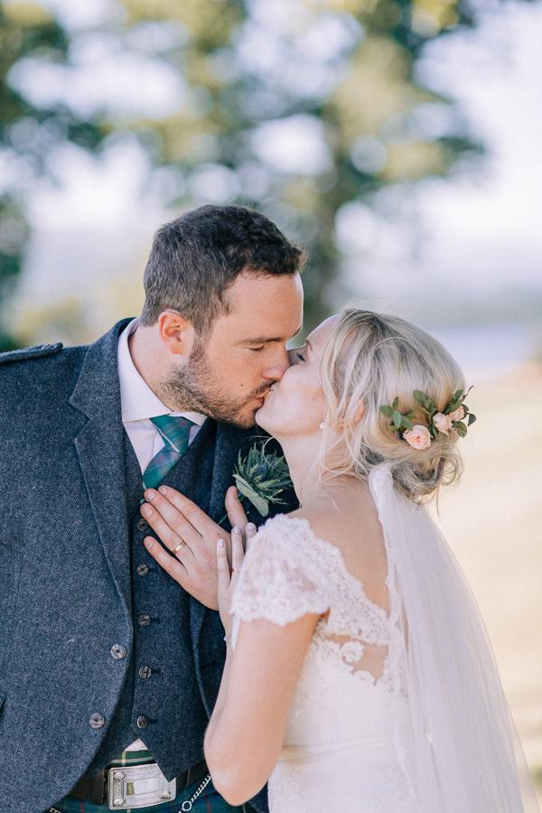a married couple kissing in the garden loch lomond