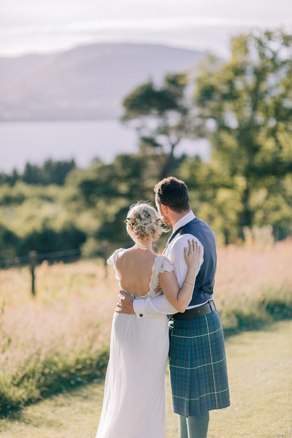 wedding couple looking at the view of loch lomond