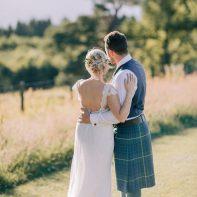 bride and groom empraced boturich castle wedding loch lomond scotland