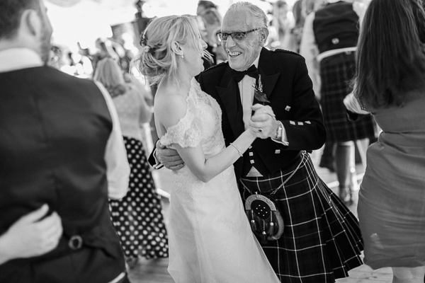granddauther and grandfather at the wedding loch lomond