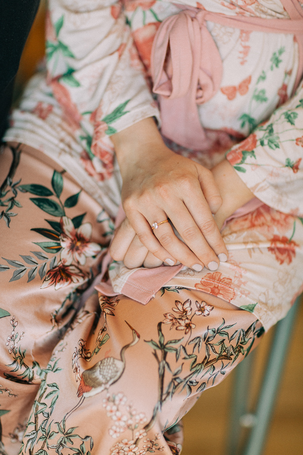 bride wears engagment ring