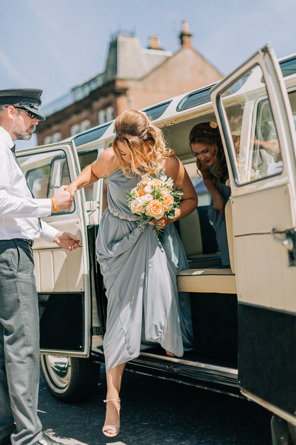 bridesmaids getting our of the car