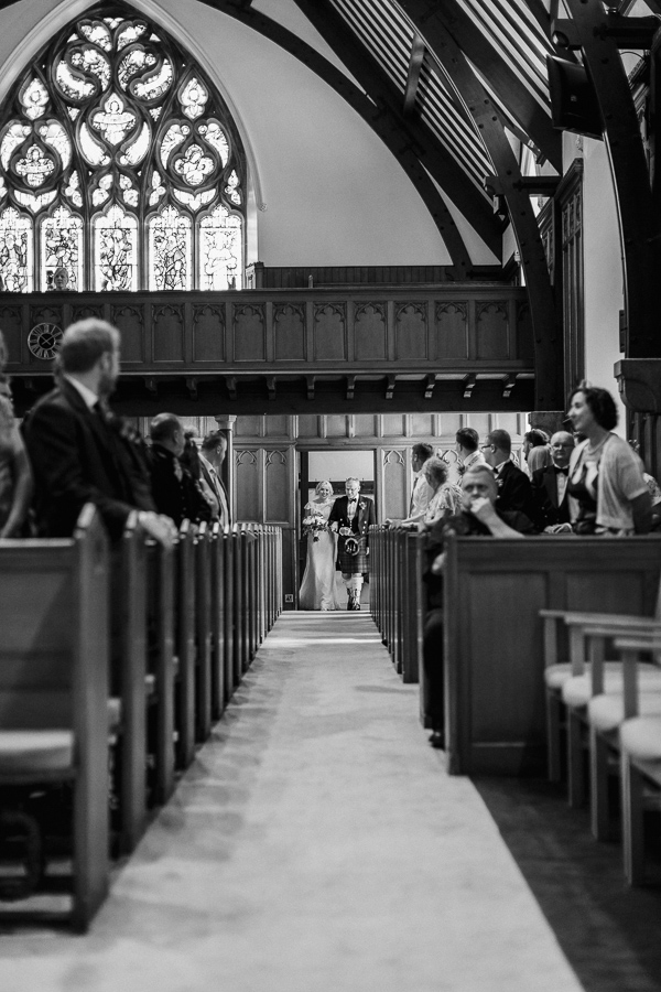 bride and her father walking on the aisle