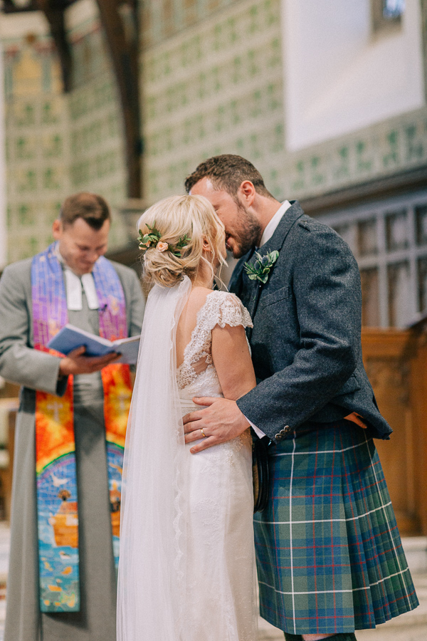 couple at the altar kissing