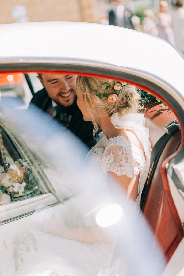 freshly married couple in the car