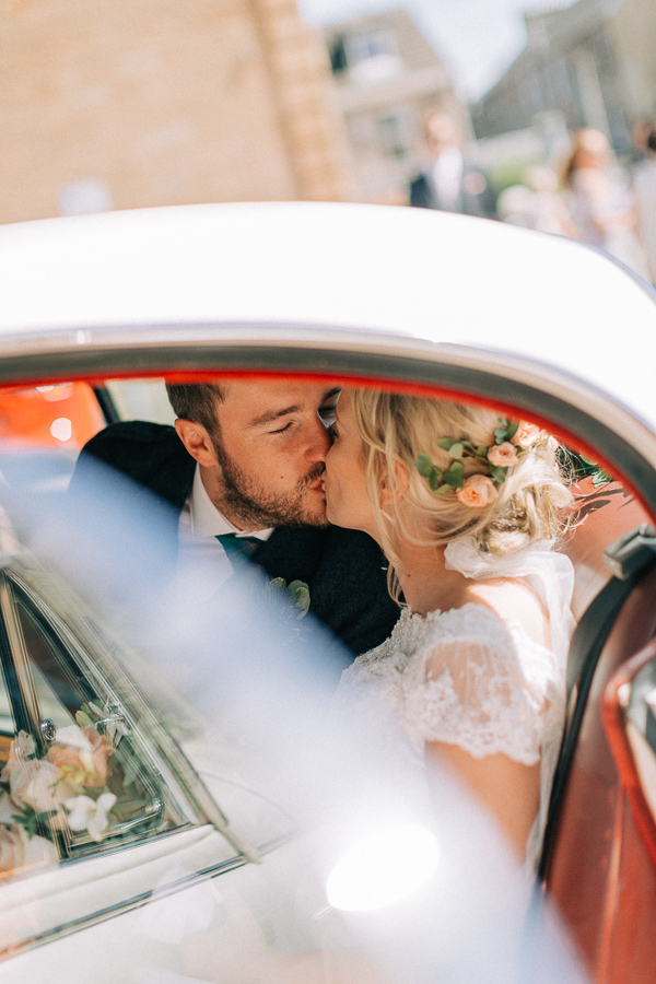 married couple kissing in the car