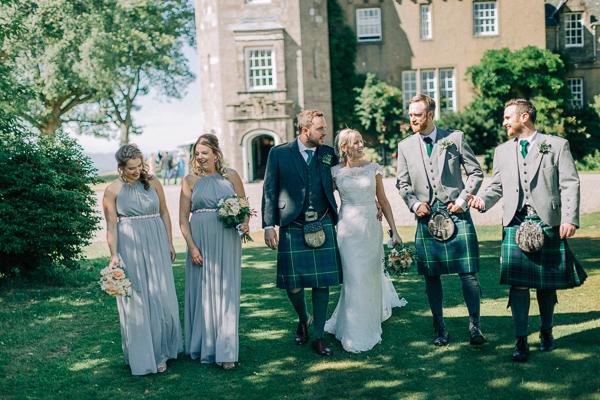 bridal party walking outside of boturich castle loch lomond