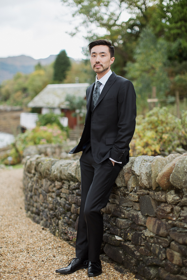 groom in full suit in garden