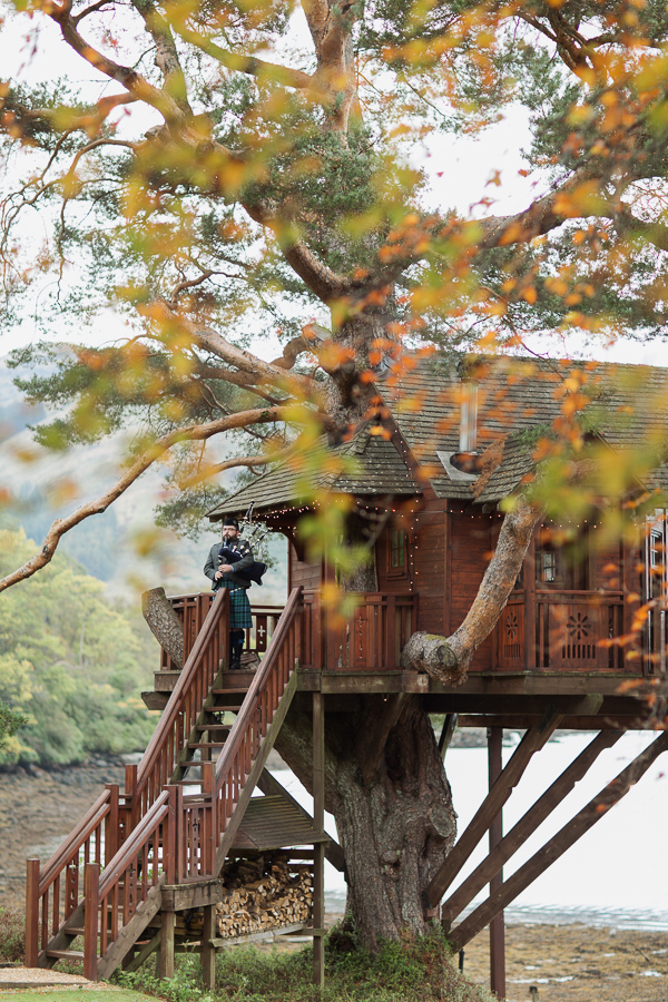 wedding photos the lodge on loch goil piper on the tree house scotland