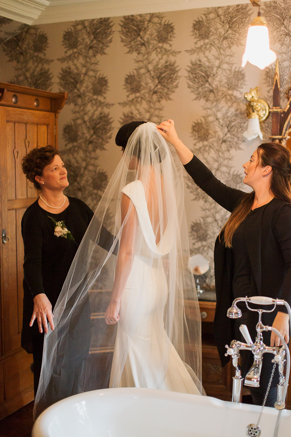 laura grey fixing brides veil at loch goil
