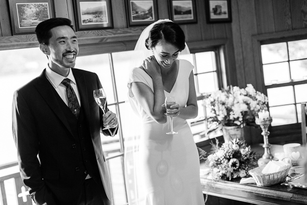 bride and groom laughing after ceremony