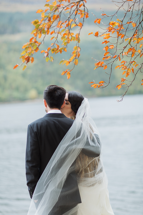 bride kissing groom wedding photo the lodge on loch goil scotland