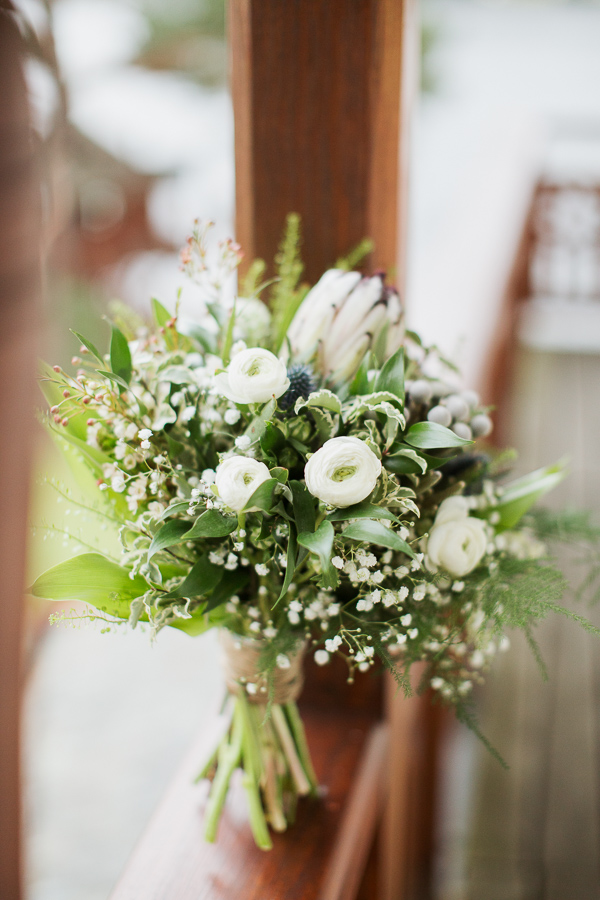 white and green wedding flowers on balcony at the lodeg scotland