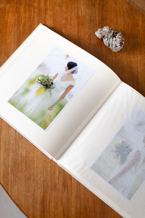 wedding album open with a picture of a bride at the lodge on loch goil