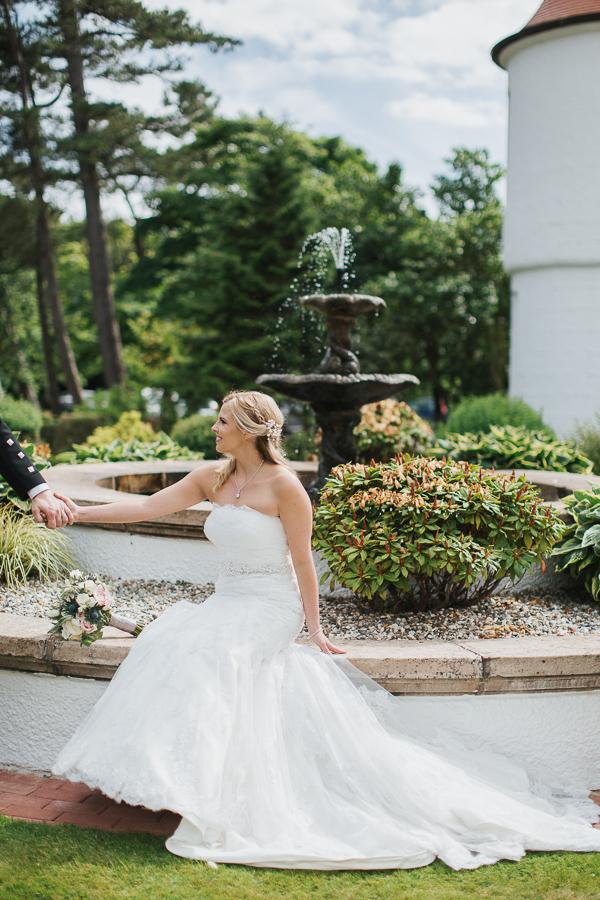 fountain at lochgreen hotel bride sitting