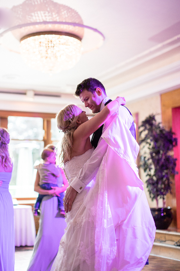 first dance bride and groom embraced