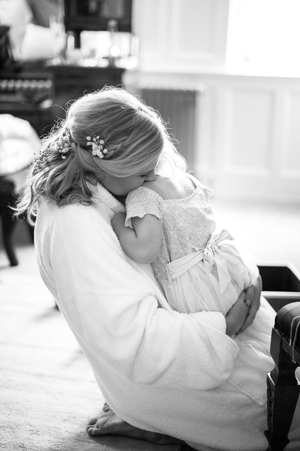 bride huging flower girl