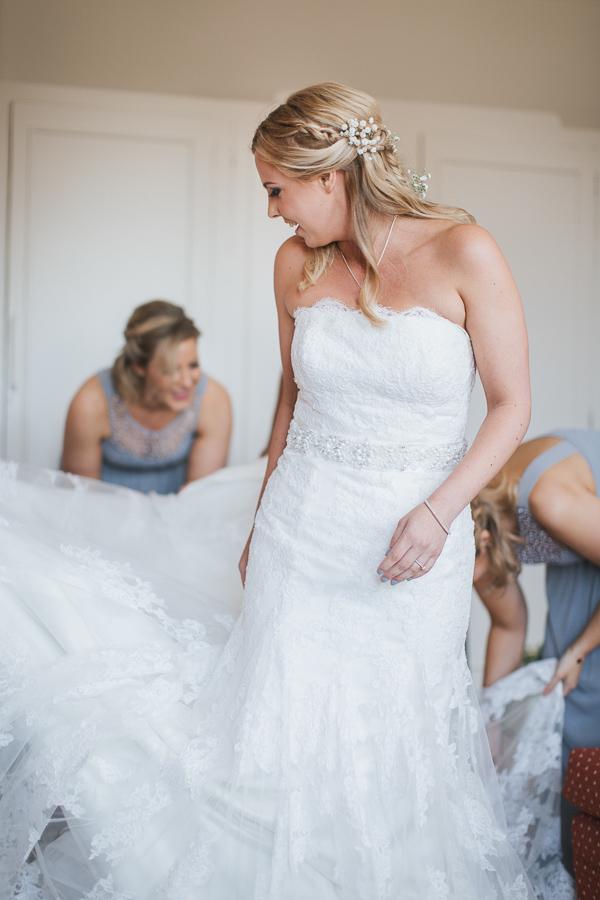 bridesmates fixing bride
