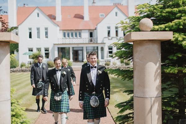 lochgreen wedding photographer groomsmen walking in the garden