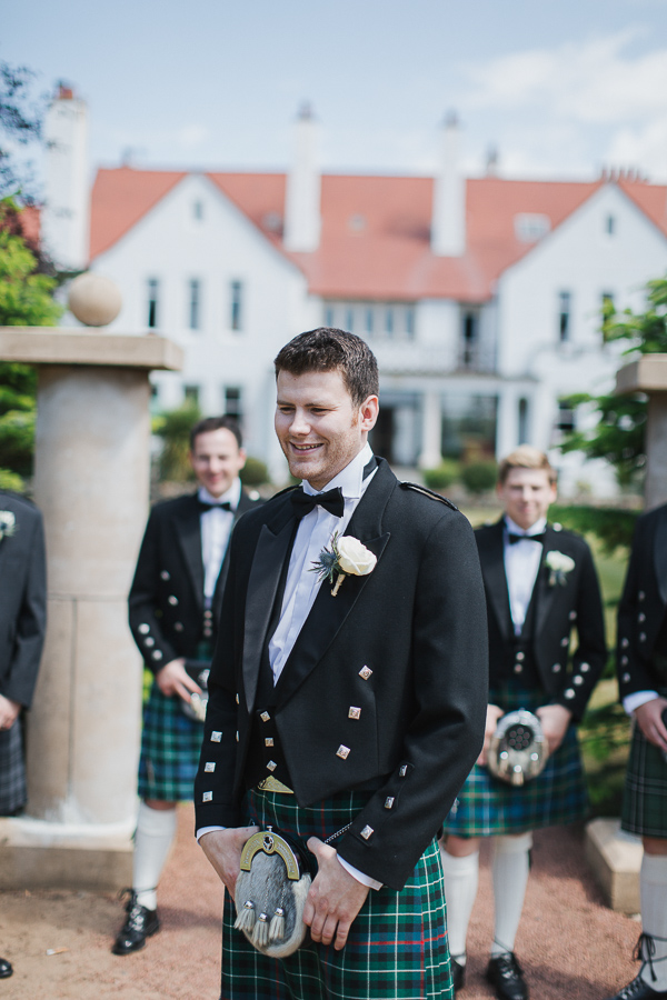 groom and his groomsmen outside the hotel in troon