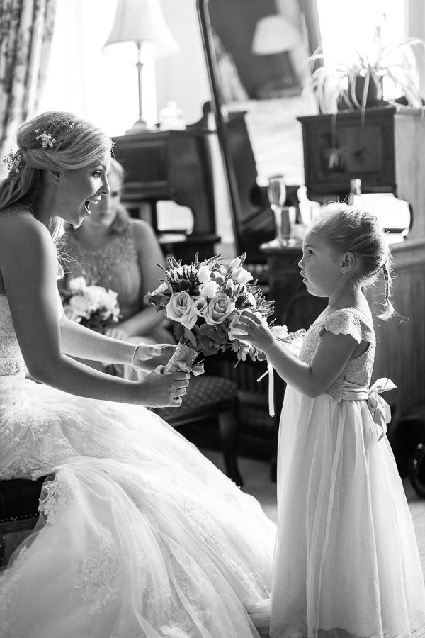 flower girl touching the bride