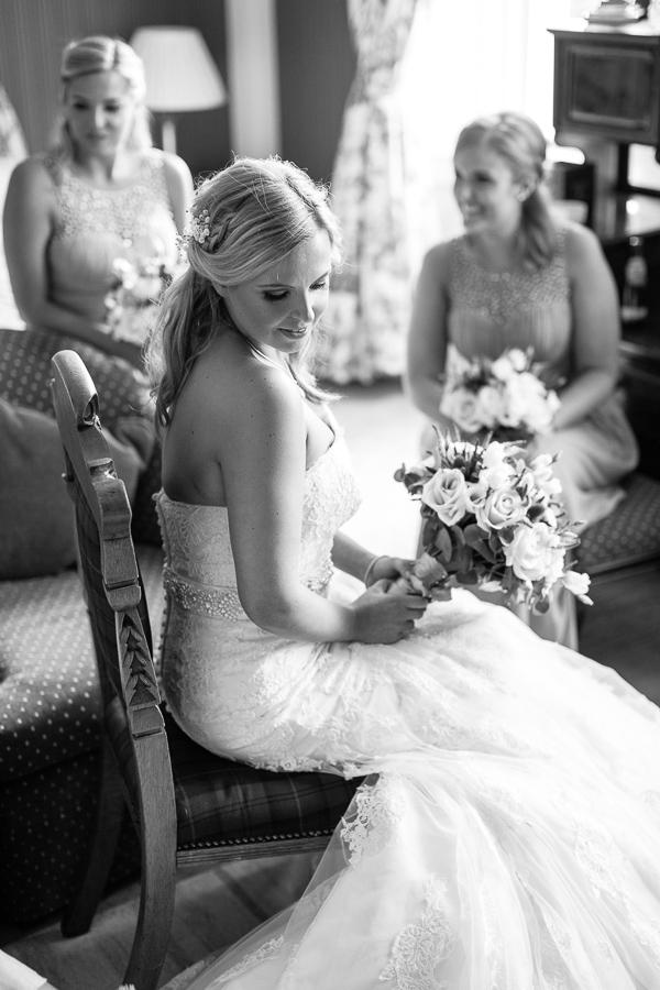 bride looking down on her dress