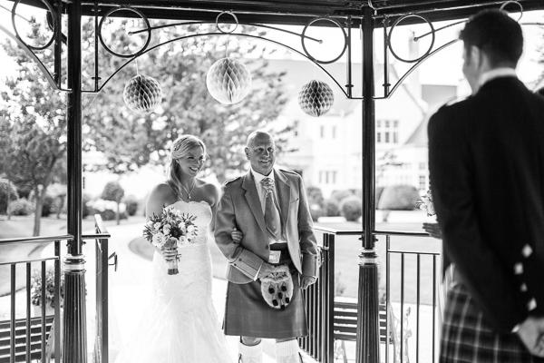 bride escorted by his dad for ceremony