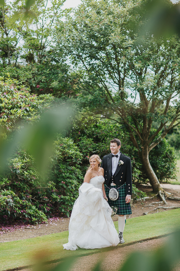 bride and groom together in the garden