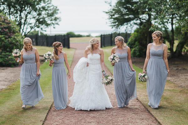 bride and bridesmates walking in the garden