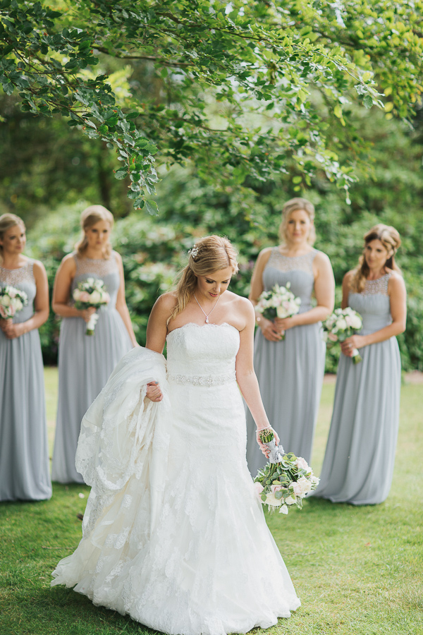 bride walking away at the garden