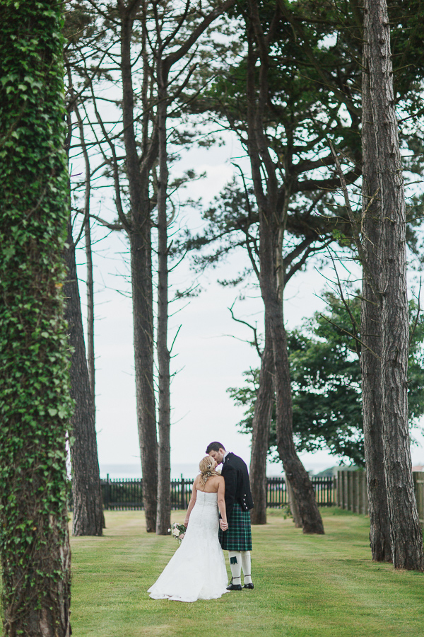 bride and groom kissing photographer ayrshire