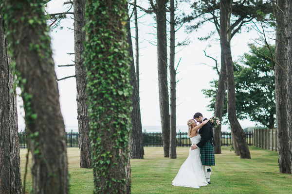 newlyweds embraced in the garden