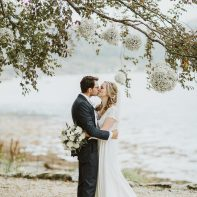 bride and groom kissing wedding at the lodge on loch goil by fotogenic of scotland