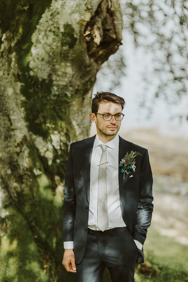 a portrait of the groom at the lodge on loch goil