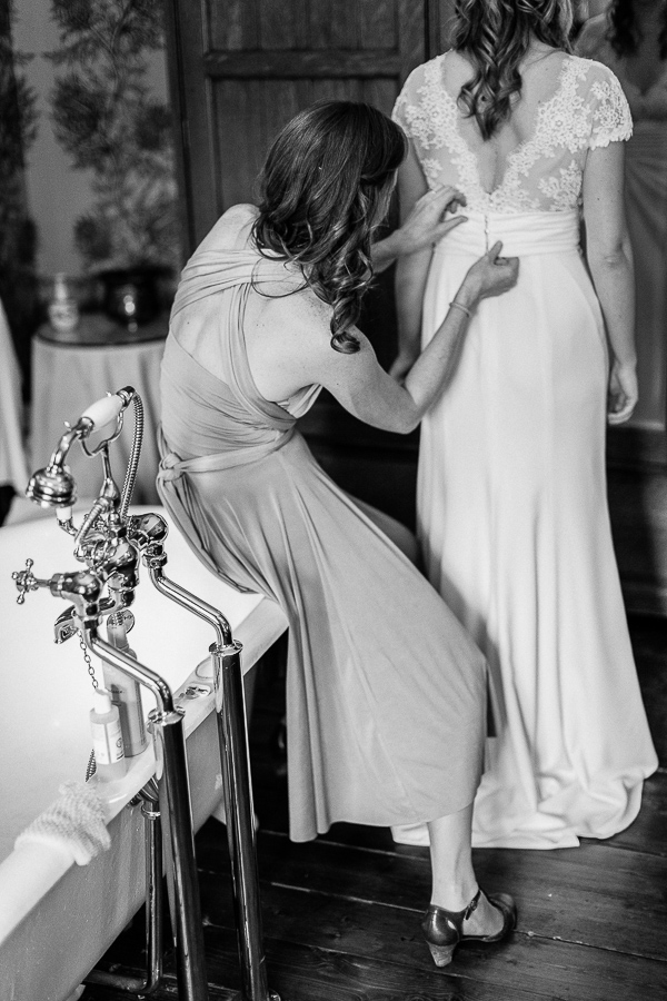bride helps with preparations