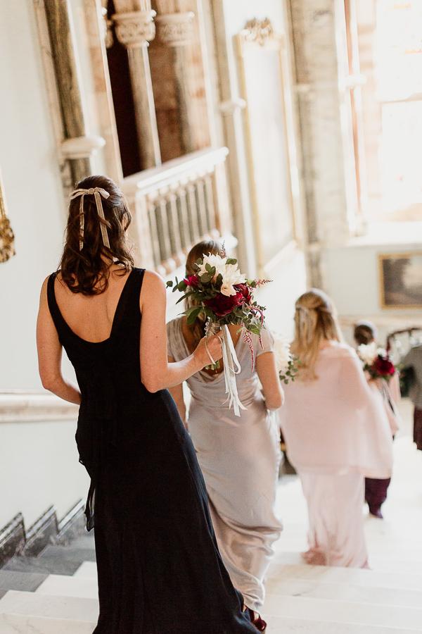 bridesmates walking down teh stairs