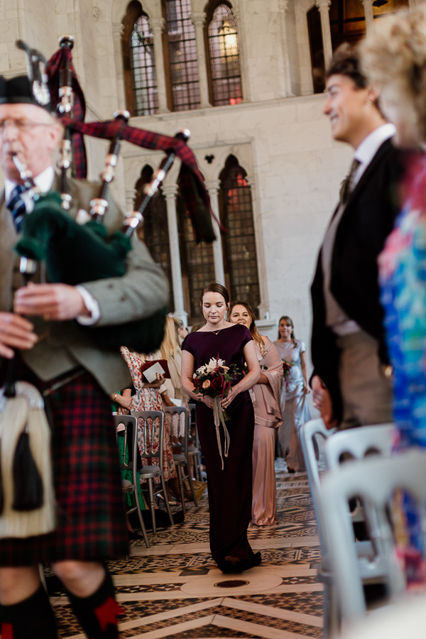bridesmates led by piper wlaking down the aisle white chapel mount stuart