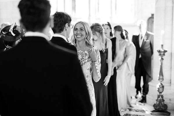 bride smiling at groom during scottish mass