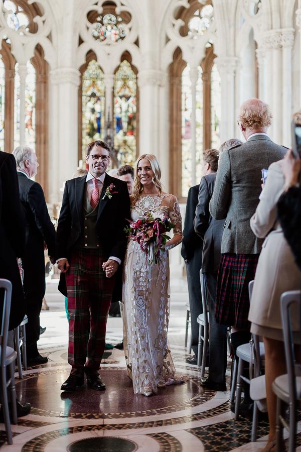 newlyweds walking down the aisle at mount stuart
